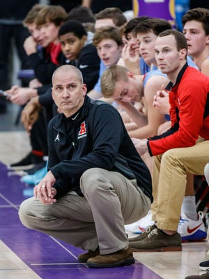 Arrowhead varsity head coach Craig Haase eyes the clock during the first half at Oconomowoc on Friday, Dec. 8, 2017.