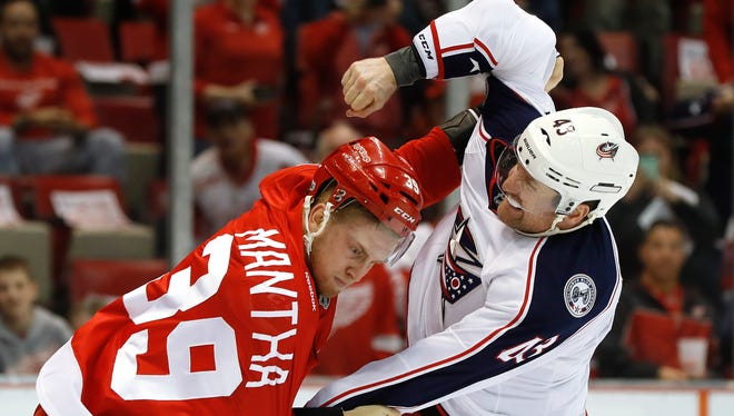 Red Wings right wing Anthony Mantha fights with Blue Jackets left wing Scott Hartnell in the first period Tuesday, Feb. 7, 2017 at Joe Louis Arena.