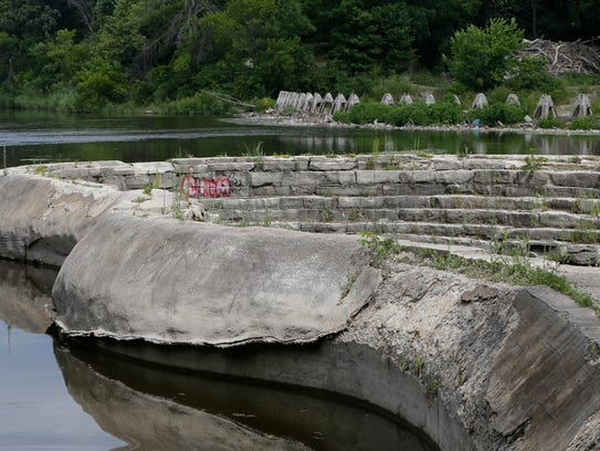 The crumbling concrete and stone spillway (foreground)
