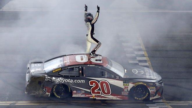 Erik Jones celebrates in front of fans after winning his first career NASCAR Cup Series race at Daytona International Speedway.