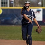 Marysville's Paige Ameel throws the ball to first during a softball this season. Ameel is part of the 12 member all-area first team