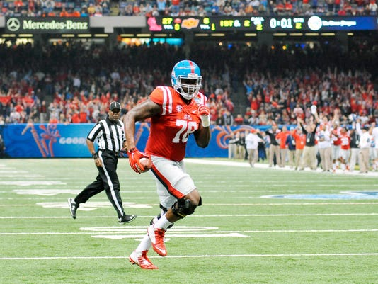 Mississippi offensive lineman Laremy Tunsil (78) runs two yards for a touchdown as time expires in the first half of the Sugar Bowl NCAA college football game against Oklahoma, Friday, Jan. 1, 2016 in New Orleans. (Bruce Newman/The Oxford Eagle via AP)  NO SALES; MANDATORY CREDIT