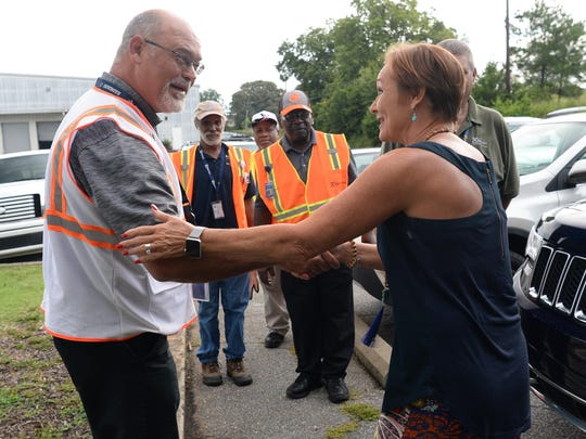 Marty McCuen, left, of Electrolux, and Kristi King-Brock of Anderson Interfaith Ministries shake hands as he delivers 24 refrigerators and several window air conditioners as donations on Thursday. One of the refrigerators was delivered to James Cherry of Anderson.