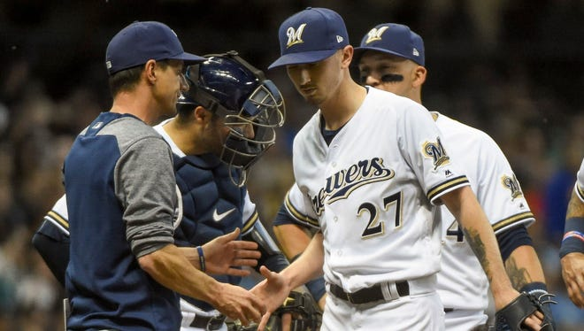 Milwaukee Brewers pitcher Zach Davies walks off the mound as manager Craig Counsell makes a pitching change in the fifth inning Thursday against the New York Mets at Miller Park.