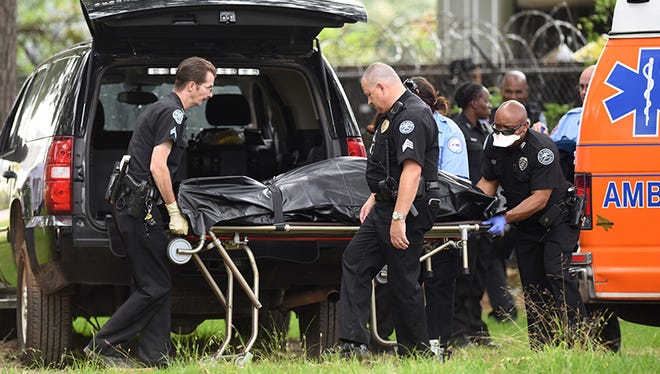 A body found at Battfield Park in Jackson Monday morning is placed into a cororner's vehicle.