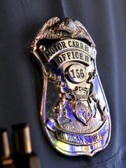 A Michigan State Police motor carrier officer badge