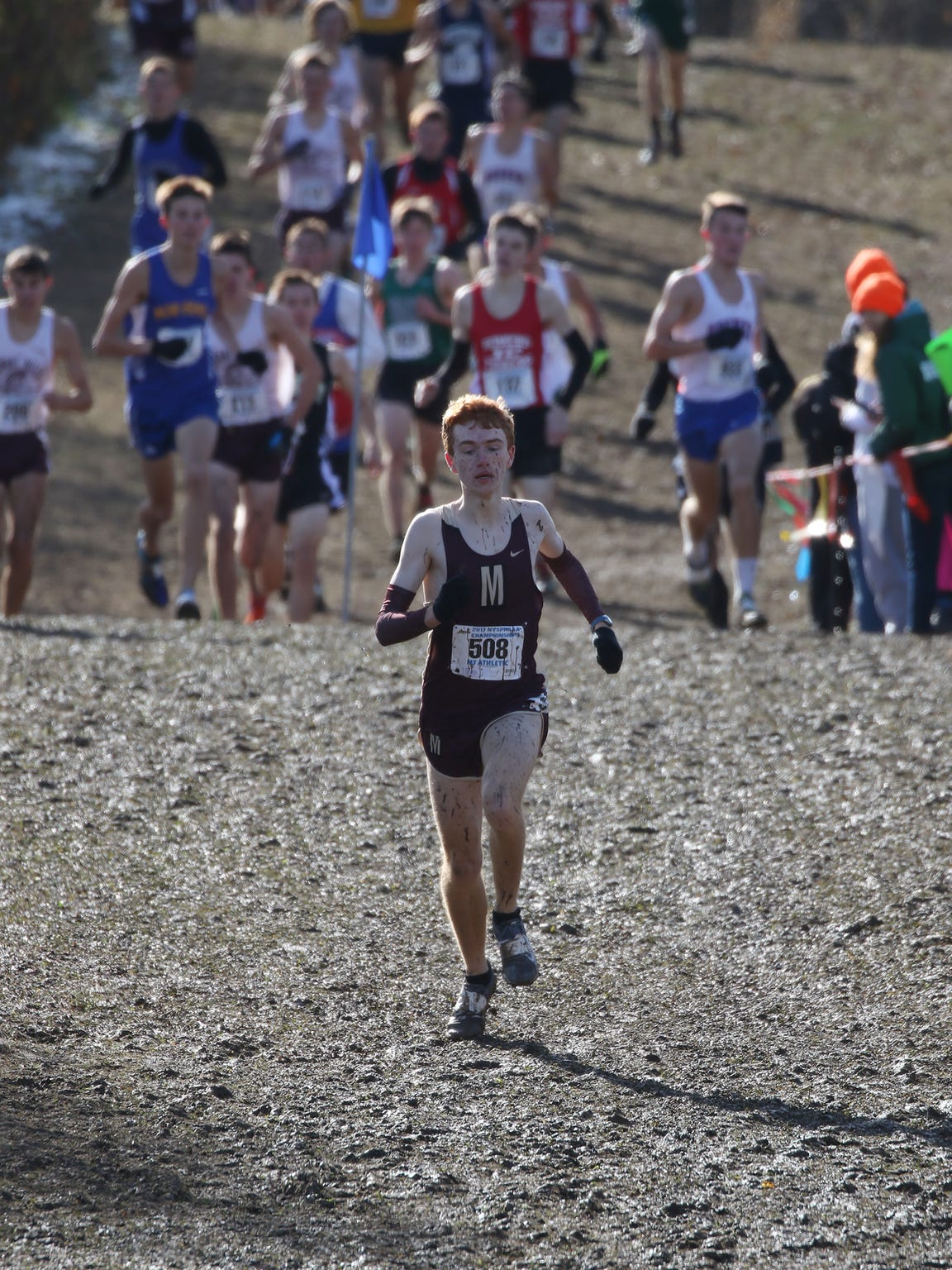 Pittsford Mendon's Nathan Lawler gets ahead of the pack of runners early during the New York State Cross Country Championship held at Wayne Central High School.