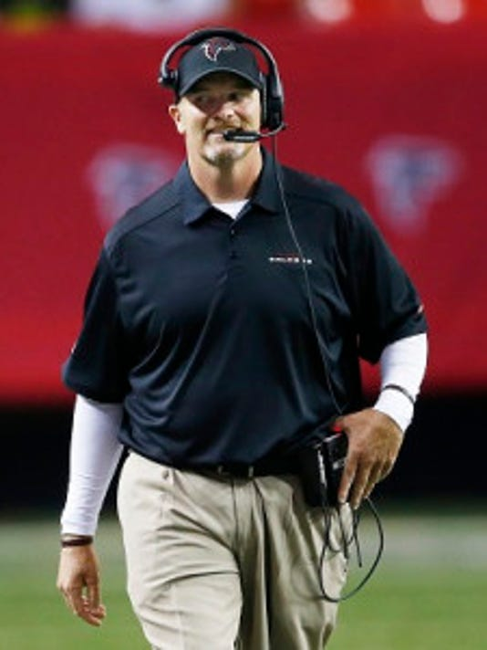 Atlanta head coach Dan Quinn walks the sideline. (AP Photo/John Bazemore)
