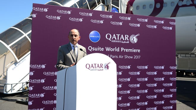 Qatar Airways CEO Akbar Al Baker speaks in front of a Boeing 777 at the Paris Air Show on June 19, 2017.