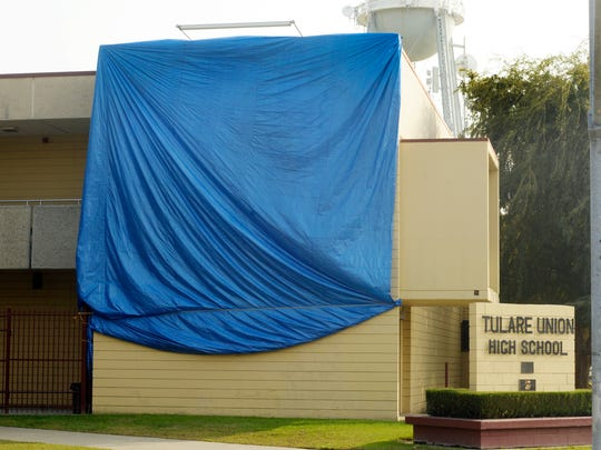 As a precaution to any shananigans during rival week every year, Tulare Union officials place a tarp over a mural on the northeast corner of the school.