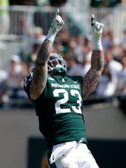 Michigan State's Chris Frey celebrates after sacking Bowling Green quarterback James Morgan (12) for a 10-yard loss during the third quarter of an NCAA college football game, Saturday, Sept. 2, 2017, in East Lansing, Mich. Michigan State won 35-10.