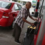 Juan Cabrera fills his vehicle with gas at a U-Gas station in Miami.