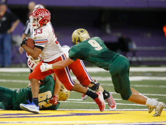 Iowa City West's Dillon Doyle (9) reaches out as Cedar