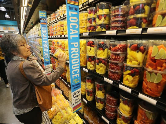 In this file photo, Kathy Staudt shopped at the local produce section of Whole Foods Market.