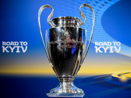 The UEFA Champions League trophy is pictured during the quarterfinal draw of the UEFA Champions League 2017/18, at the UEFA Headquarters, in Nyon, Switzerland, Friday, March 16, 2018. (Jean-Christophe Bott/Keystone via AP)