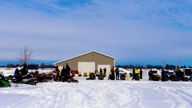 Participants were anxious to get started at last year's Spencer Swamp Stompers antique snowmobile show and ride.
