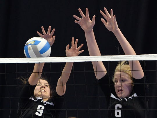 Rocori junior Ashlan Svihel (9) and sophomore Eleanor