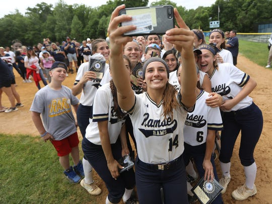Ramsey High School's Victoria Sebastian holds her cell phone above her head to take a selfie with her teammates after they became the 2018 Bergen County Softball champions on May 28. For more on the Rams, see sports.