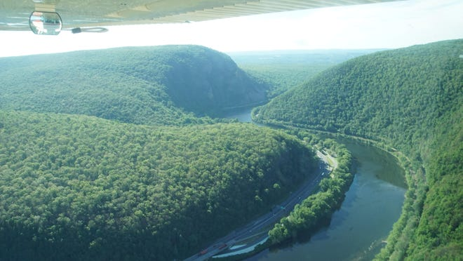The Delaware Water Gap is seen in this June 2016 aerial photo looking east with Mount Tammany on the left, Mount Minsi on the right and part of Interstate 80 on left side of the Delaware River.