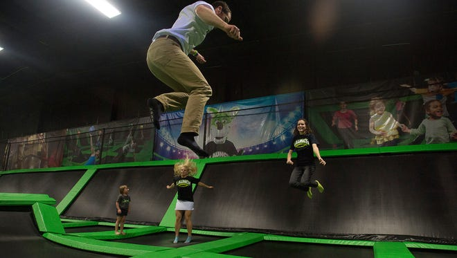 General Manager Evan McIntosh, front, attempts to flip while jumping along with staff and family Belle Bivins, left, co-owner Kristie Bivins, middle, and co-owner Jennifer Pacheco Thursday March 10, 2016 at Launch Trampoline Park in Arden. Asheville's first trampoline park is scheduled to open March 26.