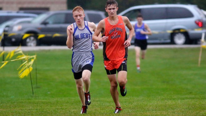 Hilbert's Garrett Franczek, left, runs by Cedar Grove-Belgium's Stephen Lavey during the Big East cross country meet, Saturday, October 14, 2017, in Sheboygan, Wis.  Franczek came in came in second and Lavey came in first.