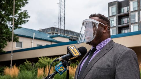 Iowa City Mayor Bruce Teague answers a question Tuesday during media availability in front of Iowa City City Hall. Teague issued an order Tuesday requiring residents to wear masks.