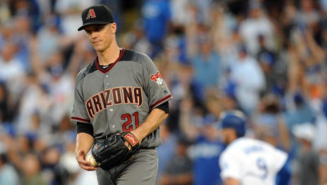 September 5, 2016: Arizona Diamondbacks starting pitcher Zack Greinke (21) reacts after giving up a solo home run in the fifth inning against Los Angeles Dodgers  catcher Yasmani Grandal (9) at Dodger Stadium.