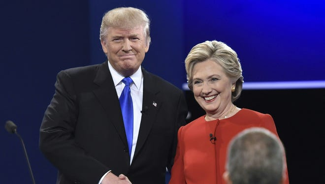 Democratic nominee Hillary Clinton shakes hands with Republican nominee Donald Trump during the first presidential debate at Hofstra University in Hempstead, New York on Monday night.