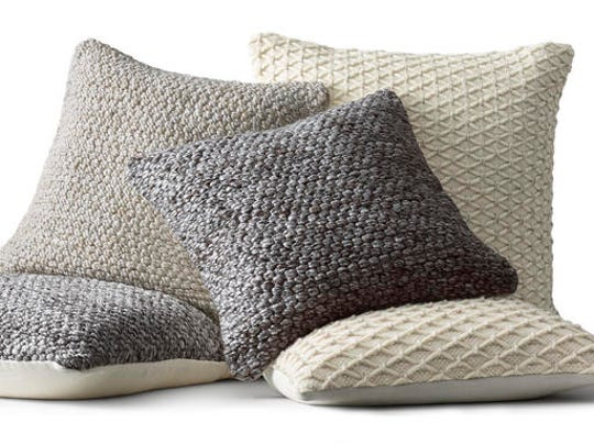 This undated photo provided by RH, Restoration Hardware, shows Ben Soleimani pillow covers. Soft wools, like these covers from Restoration Hardware's new collection, are part of the hygge vibe.