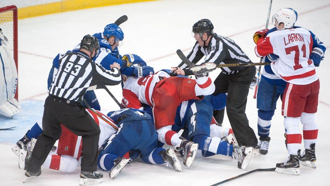 Red Wings and Lightning players mix it up near the end of Friday night's Game 2.