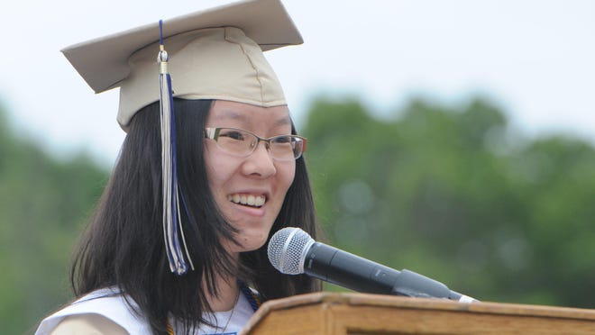 Salutatorian Yi Yi Fan addresses her classmates, guests and staff during Beacon High School's commencement ceremony at Dutchess Stadium on Saturday.