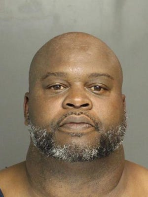 David A. Jones, 48, is accused of hitting another man with a baseball bat after a disagreement about money.