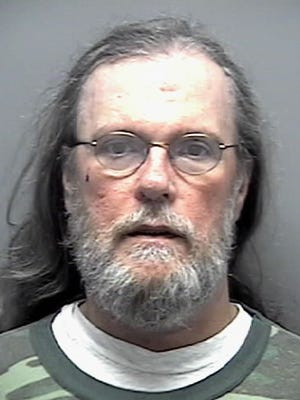 Gary Reynolds, pictured in 2003 mugshot, killed himself and a second person after driving the wrong way on the Edison Bridge.