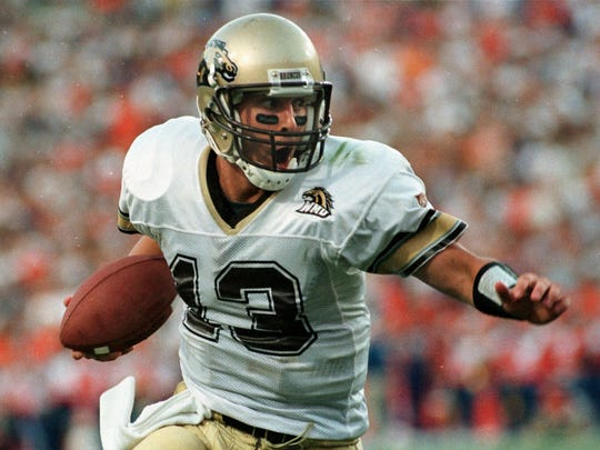 Tim Lester, who played quarterback for Western Michigan, runs with the ball against Florida on Sept. 4, 1999. Lester was named the Broncos' head coach on Jan. 13, 2017.