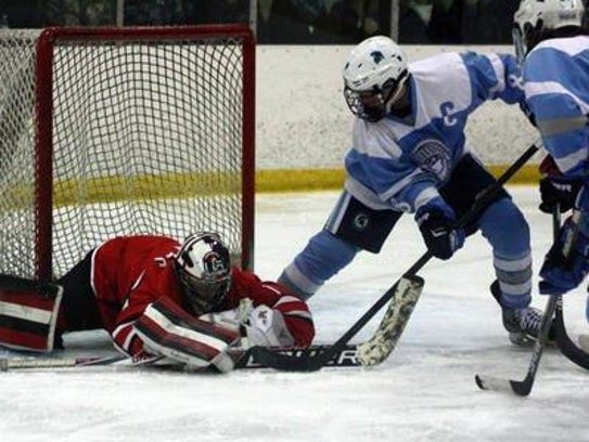 Livonia Churchill goalie Andrew Broyles thwarts a Livonia