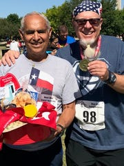 Two of the older runners Saturday took home prizes. Joe Alcorta, left, was the oldest runner (78) and won his age division. Newspaper columnist Greg Jaklewicz took a shortcut and finished second in his age division.