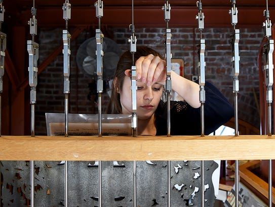 Chimemaster Emma Jacob prepares for a chimes concert