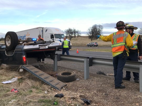First responders investigate a rollover collision that occurred Saturday afternoon on Interstate 5 in Redding just south of the Lake Boulevard exit.