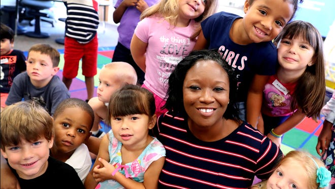 Reeves Rogers new principal Cherrye Robertson helps out with Kinder Camp, on Wednesday, July 18, 2018. The camp helps kindergarten students get acclimated to the classroom.