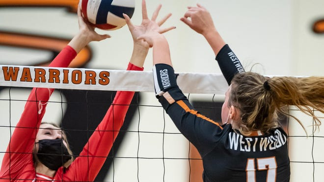 Katelyn Krienke of Vista Ridge, left, and Kenzie Beckham of Westwood joust for the ball in a District 25-6A contest Saturday at Westwood High School. Vista Ridge won the match in five sets.