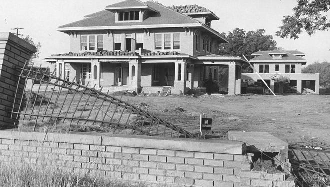 Few pictures capture the end of the oil boom era like this 1972 snapshot of the last of the houses on Wichita Falls' famed Million Dollar Row. Ed Peterson had built the mansion in 1927 at 2100 Santa Fe, keeping up with three other oil tycoons  - N.B. Chenault, Carl Baily and P.B. Cox, who had erected similarly grand mansions along Santa Fe, which had been deemed the highest point in Wichita Falls.  The homes were regaled as showplaces of high style, high living and high bank balances.  The area's booming oil production proved temporary, though, and the Depression sealed the fate of many of the city's ultra-expensive building plans. By 1972, when the Peterson home was slated for the wrecking ball, all of it's millionaire neighbors had already fallen. Today, that area of Santa Fe is dominated by apartment comlexes, the high-rise Vantage Pointe condominiums and a scattering of aging homes. Of the millionaire mansions build in the 1920s, the Weeks Mansion along Kell West near Harrison Street is likely the best-known example still standing.
