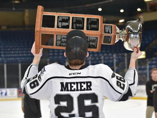 Defenseman Spencer Meier of Sartell lifts up the Clark Cup after his Fargo Force team won the United States Hockey League's playoff title on May 19 in Youngstown, Ohio. Meier is a St. Cloud State recruit.