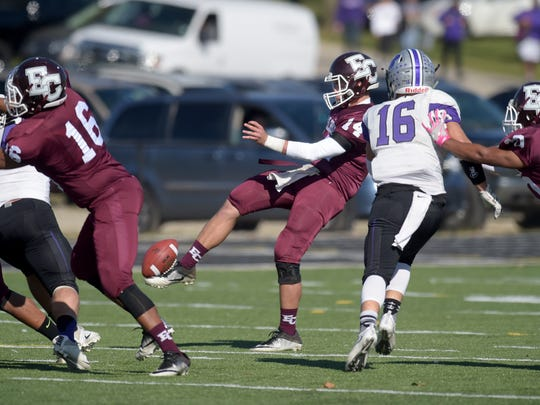Earlham's Jordan Christian punts the ball against Bluffton Saturday, Nov. 5, 2016 during a football game at Earlham College in Richmond.