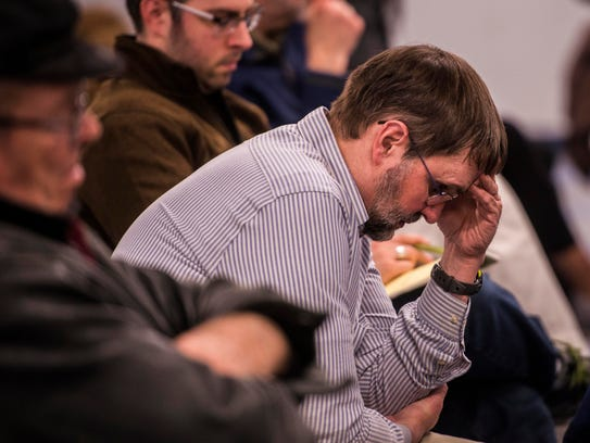 Resident Paul Stabler listens to the school board candidates'