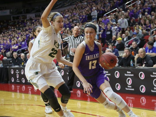 Indianola's Maggie McGraw drives past Iowa City West's Logan Cook in a Class 5A state semifinal at Wells Fargo Arena March 1.