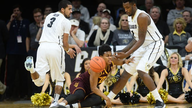 Feb. 28, 2016; Boulder, Colo.; Colorado Buffaloes guard Xavier Talton (left) and forward Wesley Gordon (right) watch as Arizona State Sun Devils guard Tra Holder loses control of the basketball in the first half at the Coors Events Center.