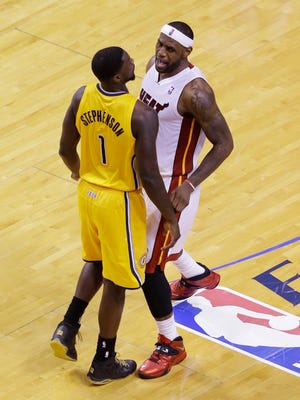 Miami Heat forward LeBron James and Indiana Pacers guard Lance Stephenson (1) exchange words during the first half of Game 3 in the NBA basketball Eastern Conference playoff series, Saturday, May 24, 2014, in Miami.