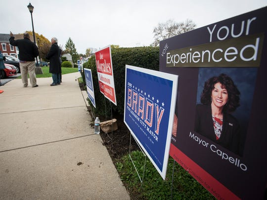 Today is election day in Lebanon. Signs for the Democratic and Republican mayoral candidates Josh Brady and Sherry Capello compete for attention outside Tabor Church in Lebanon.