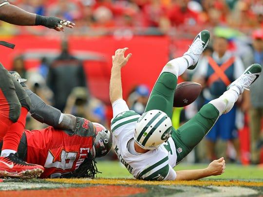 Tampa Bay Buccaneers defensive end Will Clarke sacks New York Jets quarterback Josh McCown in the first half at Raymond James Stadium.