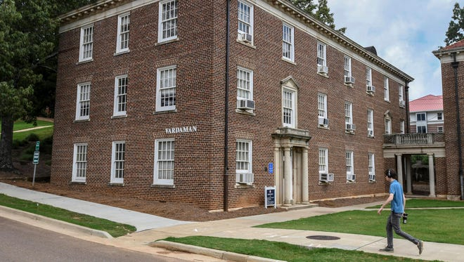 A pedestrian walks past Vardaman Hall at the University of Mississippi, in Oxford, Miss. on Thursday, July 6, 2017. The University of Mississippi will post a sign acknowledging that slaves built some structures on the main campus founded before the Civil War. The university made the announcement Thursday, also saying Ole Miss will strip the name of James K. Vardaman off a building. Vardaman, a white supremacist, was Mississippi's governor from 1904 to 1908 and a U.S. senator from 1913 to 1919.